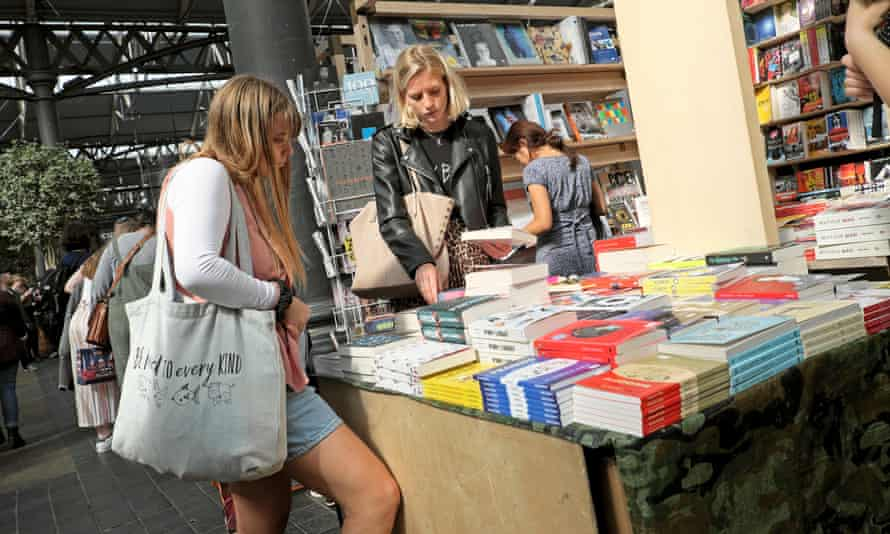 Young women browsing in book shop