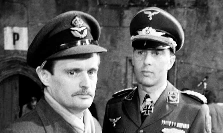 Anthony Valentine, right, as the ruthless German officer Major Horst Mohn with David McCallum in the BBC PoW series Colditz.