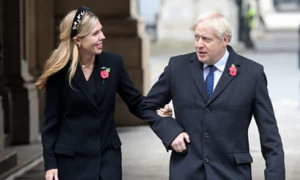 Boris Johnson and Carrie Symonds on their way to meet veterans on Remembrance Sunday