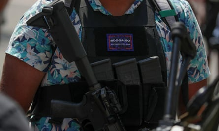 An armed protester wearing a Hawaiian shirt and a 'boogaloo' badge at a rally for second amendment gun rights near the state capitol in Richmond, Virginia, 4 July 2020.