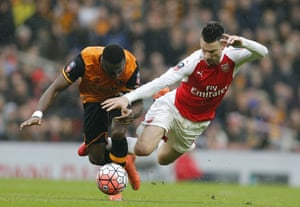 Hull''s Adama Diomande, left, is brought down by Arsenal's Laurent Koscielny.