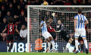 Terence Kongolo pulls a goal back for Huddersfield Town.