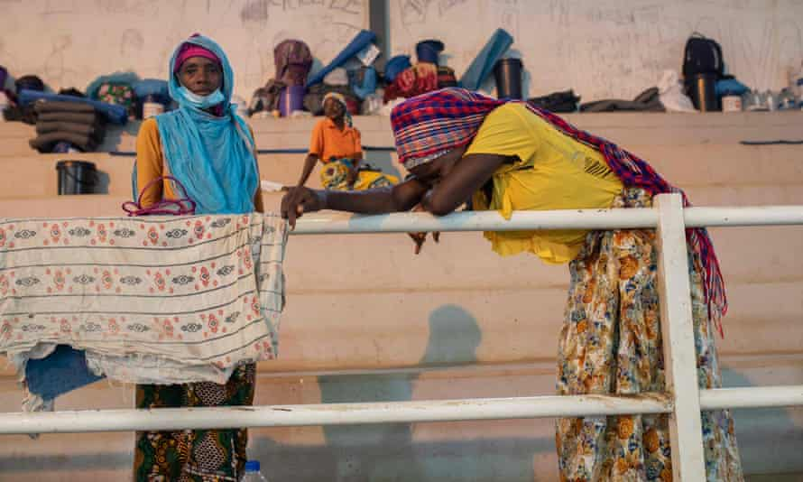 People forced to flee Palma after the attack last month gather in a sports centre in the city of Pemba, Mozambique
