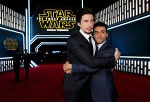 Adam Driver, left, who plays the villain Kylo Ren, and Oscar Isaac (X-wing pilot Poe Dameron) hug for the cameras