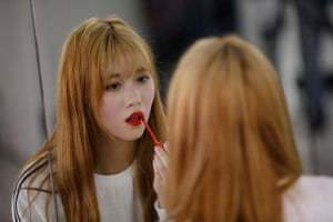 Yuho Wakamatsu adjusts her makeup during a training session in Seoul