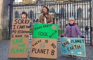 Rachel Agnew, from Broughshane, county Antrim, with son Archie, aged eight, and five-year-old daughter Bea at a climate change protest outside Belfast city hall