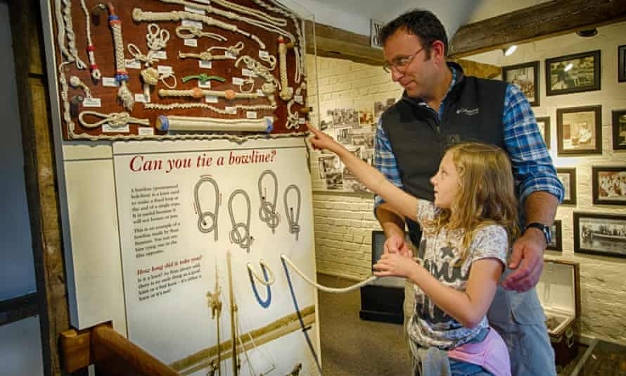 Father and his young daughter in the maritime museum at Buckler's Hard in Hampshire, UK