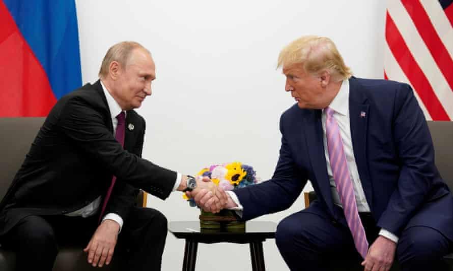 Vladimir Putin and Donald Trump shake hands during a bilateral meeting at the G20 leaders summit in Osaka last year