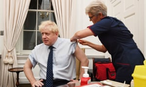 Boris Johnson is given a flu jab in Downing Street