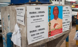 A flyposter advertising visa services in Accra.