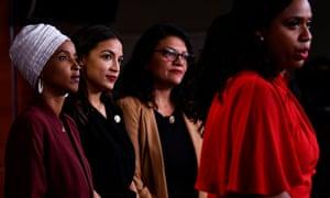 Ayanna Pressley speaks as Ilhan Omar, Alexandria Ocasio-Cortez and Rashida Tlaib listen.