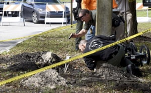 Florida, USFBI and Pembroke Pines Police investigate a tunnel by a possible would-be bank robber . The tunnel stretched from a nearby wooded area towards the Chase bank branch.