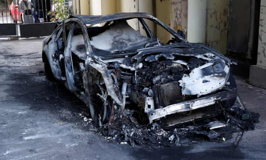 A burnt-out car reportedly owned by Gontareva's son in Kyiv
