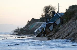 Collapsed houses lie on the beach after a storm surge in Hemsby, eastern England, in December 2013.