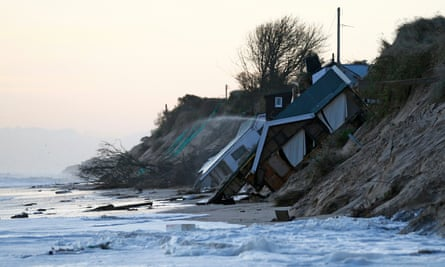 Collapsed houses lie on the beach after a storm surge in Hemsby, Norfolk, in 2013.