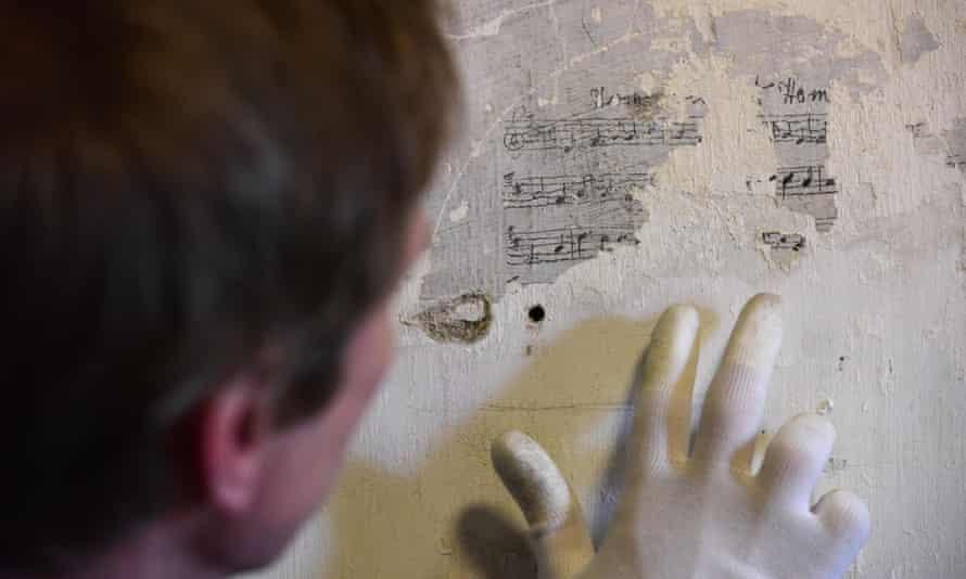Kevin Booth examining graffiti at Richmond Castle