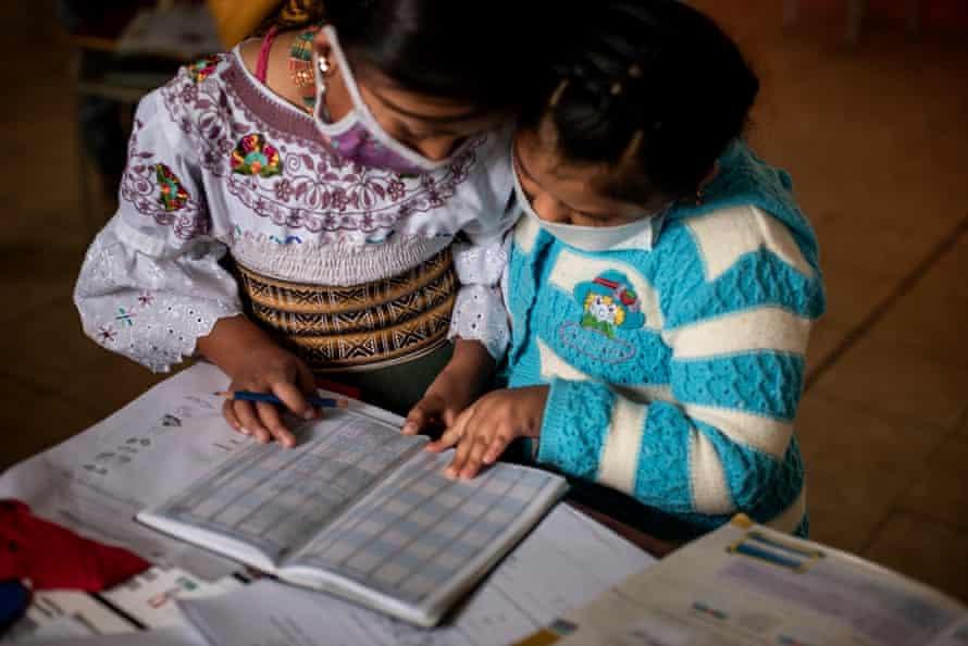 Two Karanki indigenous girls study together