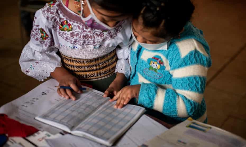 Two Karanki indigenous girls study together in San Clemente, Ecuador.