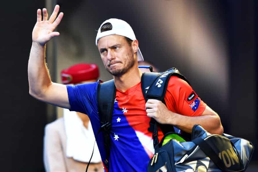 Lleyton Hewitt walks off after his Australian Open defeat to David Ferrer. Hewitt later felt moved to defend himself at the post-game press conference, saying: 'I think anyone throwing my name out there makes the whole thing an absolute farce.'