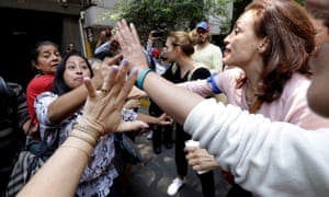Supporters of Venezuelan opposition leader Juan Guaido argue with supporters of President Nicolas Maduro during a protest outside the Venezuelan embassy in Mexico City.