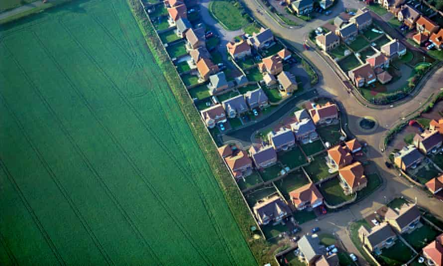 Aerial view of new housing next to countryside