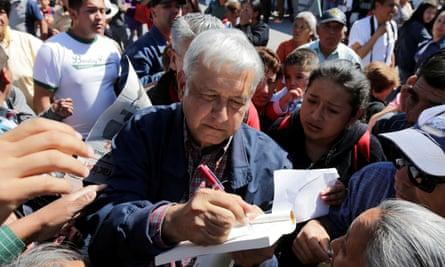 Andrés Manuel López Obrador signs an autograph after giving a speech in Tlapanaloya last month.