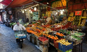 Fruit and vegetables on sale in a traditional street market in Palermo, Sicily
