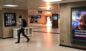 A man looks back as an explosion inside the central station in Brussels is caught on camera