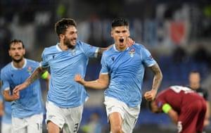 Lazio's Joaquin Correa (right) celebrates after opening the scoring with Danilo Cataldi who seems to find it funny.