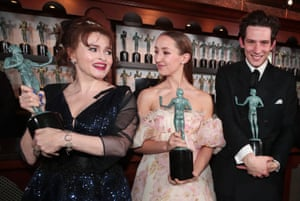 Helena Bonham Carter, Erin Doherty and Josh O'Connor with awards for outstanding performance by an ensemble in a drama series for The Crown