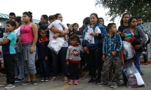 Undocumented immigrant families are released from detention at a bus depot in McAllen, Texas Monday.