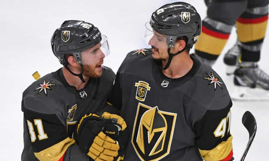 Jonathan Marchessault (left) talks with defenseman Luca Sbisa (right) after the Golden Knights defeated the San Jose Sharks 5-3.