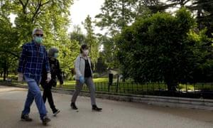 People walk in Berlin Park, Madrid, Spain.