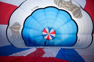 A hot air balloon is inflated for a preview flight to launch the  Bristol International Balloon Fiesta, in Bristol, UK