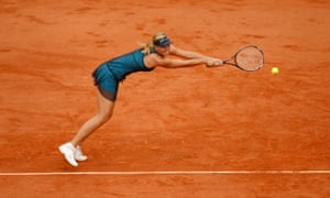 Maria Sharapova hits a return to Ana Ivanovic during the semi-finals of the 2007 French Open tennis tournament at Roland Garros