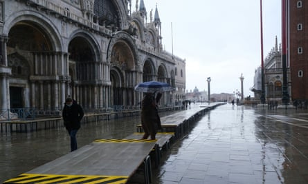 Raised walkways in St Mark's Square, Venice, during the high tide on 15 October.