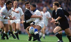 Jeremy Guscott of England drops the ball as he is tackled by Michael Jones of the All Blacks at Twickenham in 1991.