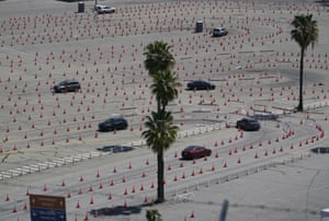 Vehicles drive around a maze of traffic cones, as they line up at the Dodgers stadium vaccination centre in Los Angeles. California has administered nearly 19 million doses, and nearly 6.9 million people are fully vaccinated in a state with almost 40 million residents.