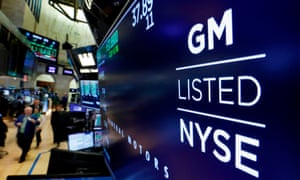 The logo for General Motors appears above a trading post on the floor of the New York Stock Exchange.