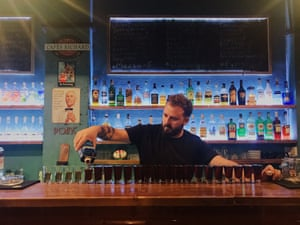 A barman pours drinks at Meoba bar