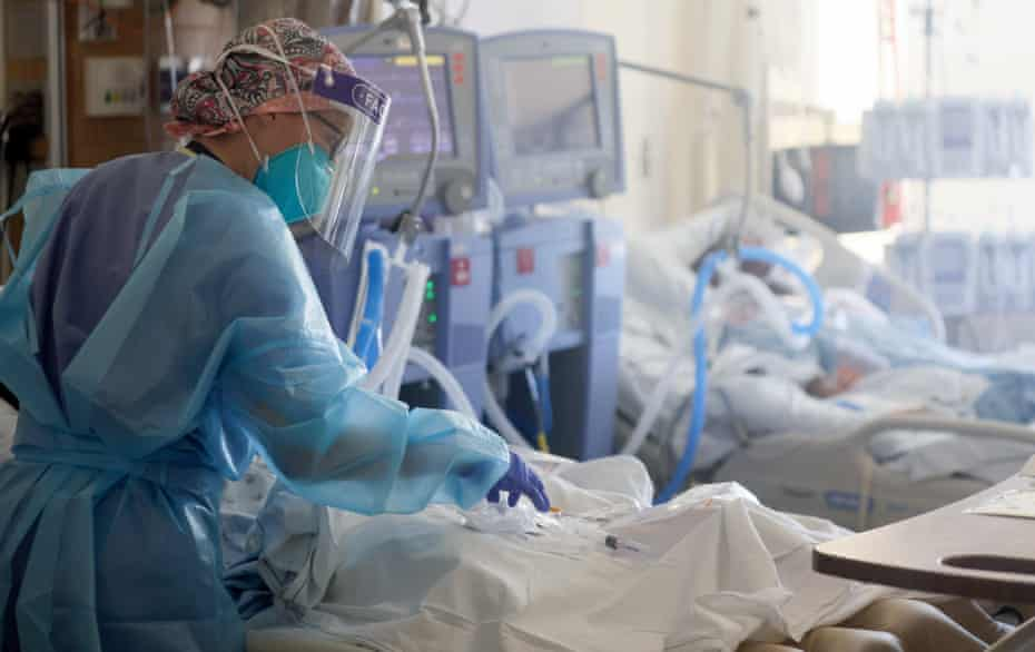 A nurse cares for patients in the Covid-19 intensive care unit at Harbor-UCLA medical center in Torrance, California.