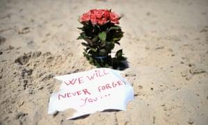 Flowers left on Marhaba beach, Tunisia, where 38 people were killed in June in an Islamist terrorist attack.