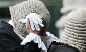 a judge adjusts their wig