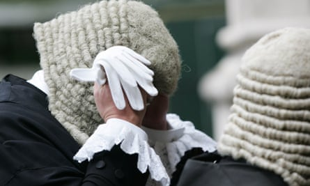 a judge adjusts their wig