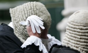 Judge adjusts his wig