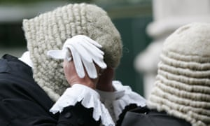 A Judge adjusts his wig as he arrives at Westminster Abbey