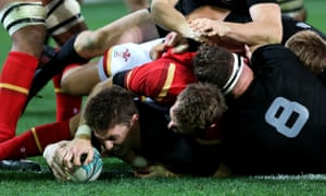 Beauden Barrett of the All Blacks dives over to score a try.
