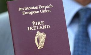 A man holding an Irish passport