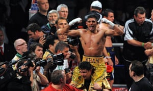 Amir Khan celebrates after dismantling Andreas Kotelnik to take the WBA light-welterweight title in 2009.