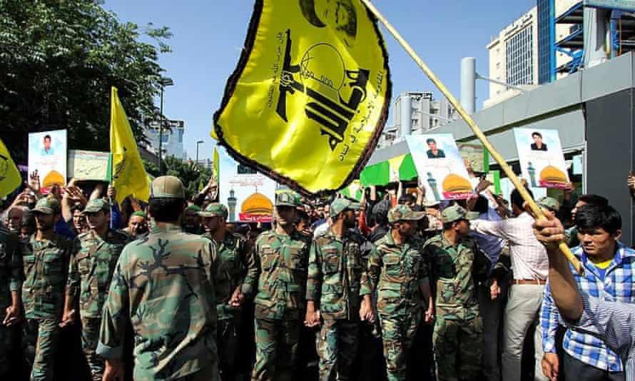 Funeral ceremonies in Mashhad, Iran, for Afghan militiamen killed in Syria.